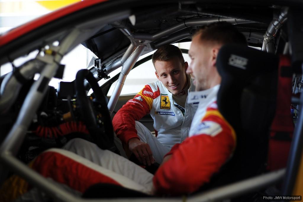 Daniel and James Walker discuss tactics. Photo: JMW Motorsport on Flickr.