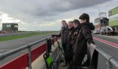 On the pit wall, watching the drivers' lines